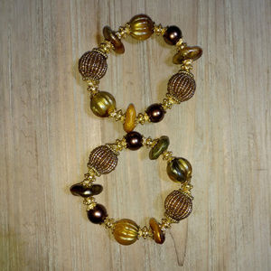 Jewelry - Pair of gold accented beaded stretch bracelets